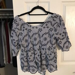 Blue blouse with floral pattern